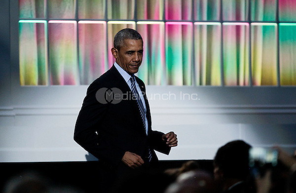United States President Barack Obama leaves the stage after delivering remarks at the International Jazz Day Concert on the South Lawn of the White House, in Washington, DC, April 29, 2016. The event includes a performance by Aretha Franklin and is presented by Morgan Freeman. <br /> Credit: Aude Guerrucci / Pool via CNP/MediaPunch