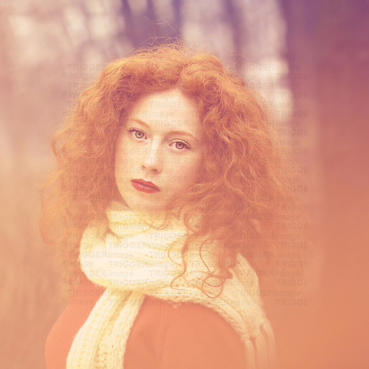 Portrait of female youth with curly red hair.