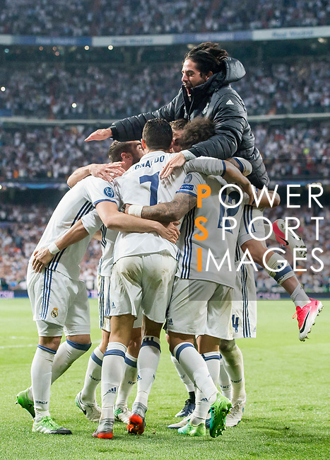 Cristiano Ronaldo of Real Madrid celebrates with teammates during their 2016-17 UEFA Champions League Quarter-finals second leg match between Real Madrid and FC Bayern Munich at the Estadio Santiago Bernabeu on 18 April 2017 in Madrid, Spain. Photo by Diego Gonzalez Souto / Power Sport Images