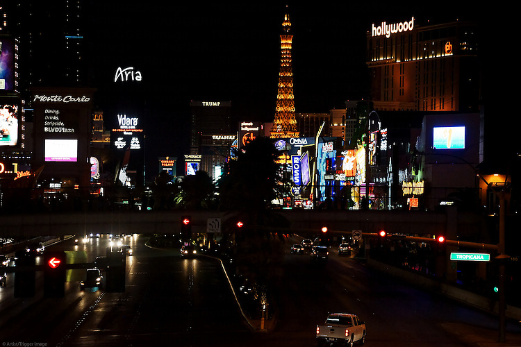 Road traffic on the Las Vegas Boulevard or Strip with a collection of luxury hotels and casinos on the night in Las Vegas.