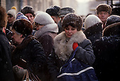 Moscow, Russia<br /> Soviet Union<br /> December 9, 1991<br /> <br /> People line up to buy sugar during a snow storm. A typical scene from the days in the former Soviet Union. <br /> <br /> In December 1991, food shortages in central Russia had prompted food rationing in the Moscow area for the first time since World War II. Amid steady collapse, Soviet President Gorbachev and his government continued to oppose rapid market reforms like Yavlinsky's &quot;500 Days&quot; program. To break Gorbachev's opposition, Yeltsin decided to disband the USSR in accordance with the Treaty of the Union of 1922 and thereby remove Gorbachev and the Soviet government from power. The step was also enthusiastically supported by the governments of Ukraine and Belarus, which were parties of the Treaty of 1922 along with Russia.<br /> <br /> On December 21, 1991, representatives of all member republics except Georgia signed the Alma-Ata Protocol, in which they confirmed the dissolution of the Union. That same day, all former-Soviet republics agreed to join the CIS, with the exception of the three Baltic States.