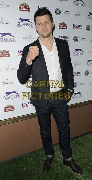 Carl Froch<br /> attended the Slazenger Wimbledon Party, Whisky Mist bar &amp; nightclub, Hertford St., London, England, UK, 27th June 2013.<br /> full length white shirt jeans black jacket blazer hand fist <br /> CAP/CAN<br /> &copy;Can Nguyen/Capital Pictures
