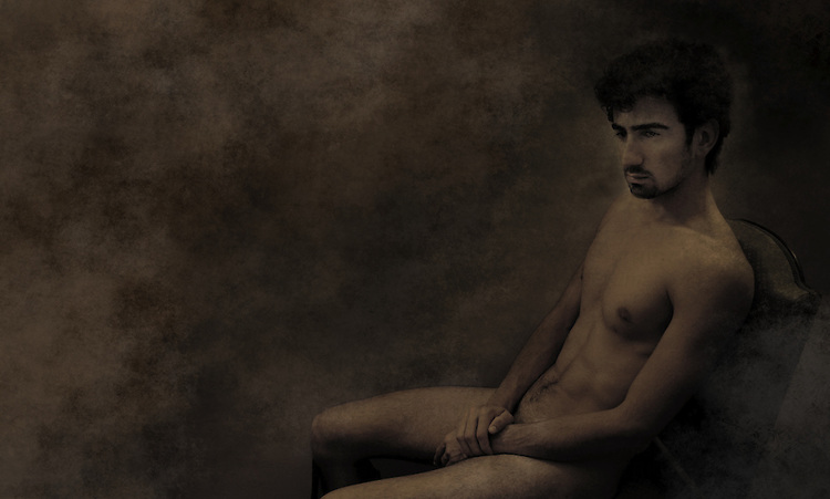 A naked young man sitting quietly