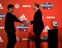MLS commissioner Don Garber welcomes Austin Da Luz to the stage as the fourteenth overall pick of  the MLS Superdraft by the New York Red Bulls at the Pennsylvania Convention Center in Philadelphia, PA.