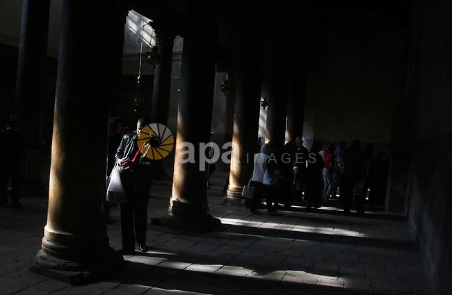 Christian pilgrims visit the Church of the Nativity in the biblical West Bank city of Bethlehem on 23 December 2011 as Christian pilgrims start gathering in the church belived to be the birthplace of Jesus Christ to celebrate Christmas on 24 December. Photo by Issam Rimawi