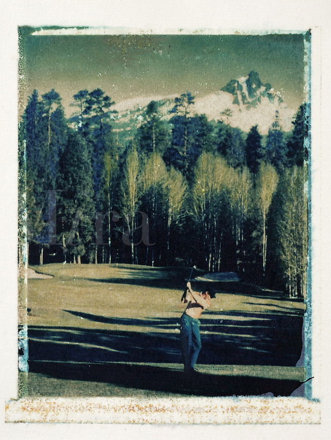 Vintage style golfer on the 14th hole of the Black Butte course. Sisters, Oregon.