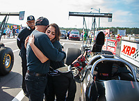 Mar 15, 2019; Gainesville, FL, USA; NHRA top alcohol dragster driver Jasmine Salinas (right) with father Mike Salinas during qualifying for the Gatornationals at Gainesville Raceway. Mandatory Credit: Mark J. Rebilas-USA TODAY Sports