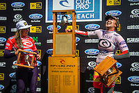 BELLS BEACH, Victoria/AUS (Monday, April 1, 2013) Tyler Wright (AUS) and Carissa Moore (HAW). - Pristine three-to-five foot (1 - 1.5 metre) waves rolled through the aquatic amphitheater of Bells Beach today as the world's best surfers battled through three electric rounds of the Rip Curl Pro Bells Beach presented by Ford..Stop No. 2 of 10 on the 2013 ASP World Championship Tour (WCT), the Rip Curl Pro Bells Beach recommences the hunt for this year's world surfing crown and the unprecedented array of high-performance surfing at Bells Beach today yielded some incredible upsets and astonishing surfing action..Kelly Slater (USA), 41, 11-time ASP World Champion and current ASP WCT No. 1, suffered a shock elimination this morning at the hands of injury replacement Willian Cardoso (BRA), 27..Joel Parkinson (AUS), 31, reigning ASP World Champion and three-time Rip Curl Pro Bells Beach winner (2004, 2009, 2011), moved quick to capitalize on Slater's uncharacteristic loss, posting a 9.10 and a Perfect 10 in the following heat. The incredible scoreline, however, would not be enough to overcome a rampaging Raoni Monteiro (BRA), 30, who posted a 19.17 to cause the second major upset of the morning...While Monteiro would ultimately fall to two-time ASP World Champion (2007, 2009) Mick Fanning (AUS), 31, in Round 5, Cardoso continued his juggernaut performance at Bells Beach this afternoon, crushing a Round 4 heat and advancing directly into the Quarterfinals..Jordy Smith (ZAF), 25, continued to dominate Rip Curl Pro Bells Beach competition today, posting an 18.27 in Round 3 and a 19.10 in Round 4 to advance directly into the Quarterfinals...Other perennial threats to capitalize on the early departures of Slater and Parkinson were Taj Burrow (AUS), 35, and Mick Fanning (AUS), 31, who are both into the Quarterfinals of the Rip Curl Pro Bells Beach..Nat Young (USA), 21, 2013 ASP Dream Tour rookie, continued to display a backhand mastery today, eliminating dangerous veteran Josh Kerr