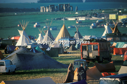 1970's style hippies attend the second free festival at Stonehenge to celebrate the summer solstice June 21st 1975