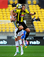 Andrija Kaludjerovic goes up for a header during the A-League football match between Wellington Phoenix and Adelaide United FC at Westpac Stadium in Wellington, New Zealand on Sunday, 8 October 2017. Photo: Dave Lintott / lintottphoto.co.nz