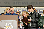 APRIL 16, 2011 - MERRICK, NY: Robbie Rosen and (holding flowers) his mother Lauren  look at plaque he received from (at podium) President of Merrick Chamber of Commerce, Randy Shotland, to honor the American Idol contestant, at Robbie Rosen Day at Merrick Kid Fest, at Merrick, Long Island, New York, USA. (EDITORIAL USE ONLY)
