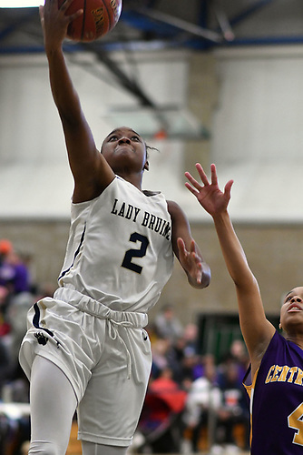 Aziah Hudson #2 of Baldwin, left, drives to the net for two points during the Class AA varsity girls basketball Long Island Championship against Central Islip at SUNY Old Westbury on Saturday, March 11, 2017. Baldwin, who led by one point (31-30) late in the third quarter, used a 22-0 run spanning the third and fourth quarters en route to a 56-31 win.