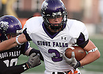 SIOUX FALLS, SD - APRIL 28: Tyler Ollerich #3 of the University of Sioux Falls slips the grasp of defender Robert Virgil during the Cougars spring scrimmage Saturday evening at Bob Young Field. (Photo by Dave Eggen/Inertia)