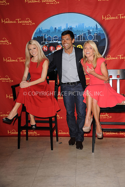 WWW.ACEPIXS.COM.April 5 2001 in New York City.... Mark Consuelos and Kelly Ripa unveil her wax figure at Madame Tussauds on April 5 2011 in New York City ....Please byline: KRISTIN CALLAHAN - ACEPIXS.COM....ACE Pictures, Inc: Tel: (212) 243 8787 or (646) 769 0430... email: info@acepixs.com...web: http://www.acepixs.com