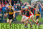 Action from the AIB Munster Club Junior Hurling Championship Quarter Final play last Sunday in Dromcollogher, Dr Crokes against Dromcollogher-Broadford. Chris Doncel races past Derry McCarthy, Kevin Noonan and Garrett Noonan of Dromcollogher-Broadford.