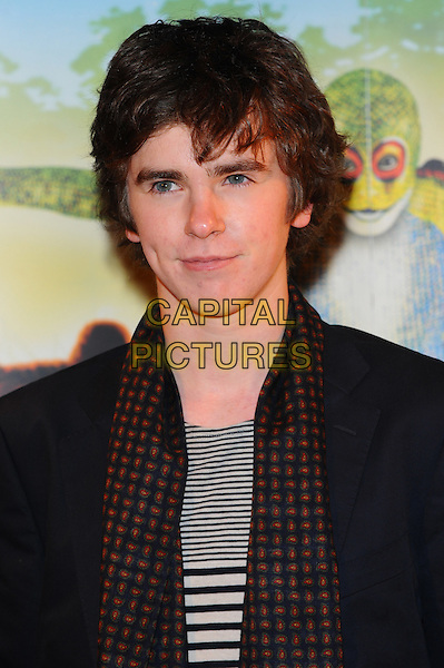 Freddie Highmore.'Cirque Du Soleil: Totem' UK Premiere, Royal Albert Hall, London, England..5th January 2012.headshot portrait black white jacket stripes striped scarf print .CAP/CJ.©Chris Joseph/Capital Pictures.