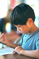 Boy age 5 taking safety test at Youth Express Bicycle Rodeo.  St Paul  Minnesota USA
