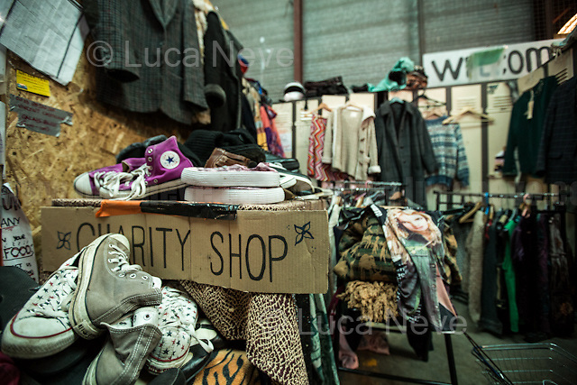 """Charity Shop.<br /> <br /> Main Warehouse """"L'Auberge"""" where donations - including food - are managed and then distributed to the camps. <br /> <br /> Under the Sky of Calais & Dunkirk. Two Camps, Two Sides of the Same Coin: Not 'migrants', Not 'refugees', just Humans.<br /> <br /> France, 24-30/03/2016. Documenting (and following) Zekra and her experience in the two French camps at the gate of the United Kingdom: Calais' """"Jungle"""" and Dunkirk's """"Grande-Synthe"""". Zekra lives in London but she is originally from Basra in Iraq. Zekra and her family had to flee Kuwait - where they moved for working reason - due to the """"Gulf War"""", and to the Western Countries' will to """"export Democracy in Iraq"""". Zekra is a self-motivated volunteer and founder of """"Happy Ravers"""", a group of people (not a NGO or a charity) linked to each other because of their love for rave parties but also men and women who meet up every week to help homeless people and other people in need in Central London. (Here there are some of the stories I covered about Zekra and """"Happy Ravers"""": http://bit.ly/1XVj1Cg & http://bit.ly/24kcGQz & http://bit.ly/1TY0dPO). Zekra worked as an English teacher in the adult school at Dunkirk's """"Grande-Synthe"""" camp and as a cultural mediator and Arabic translator for two medic teams in Calais' """"Jungle"""". Please read her story at the beginning of this reportage."""