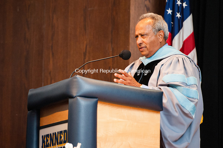 WATERBURY, CT-27 June 2014-062714EC02-  Paul Sequeira, a special advisor to the Superintendent who is retiring this year, greets graduates at Kennedy High School graduation this year. Erin Covey Republican-American