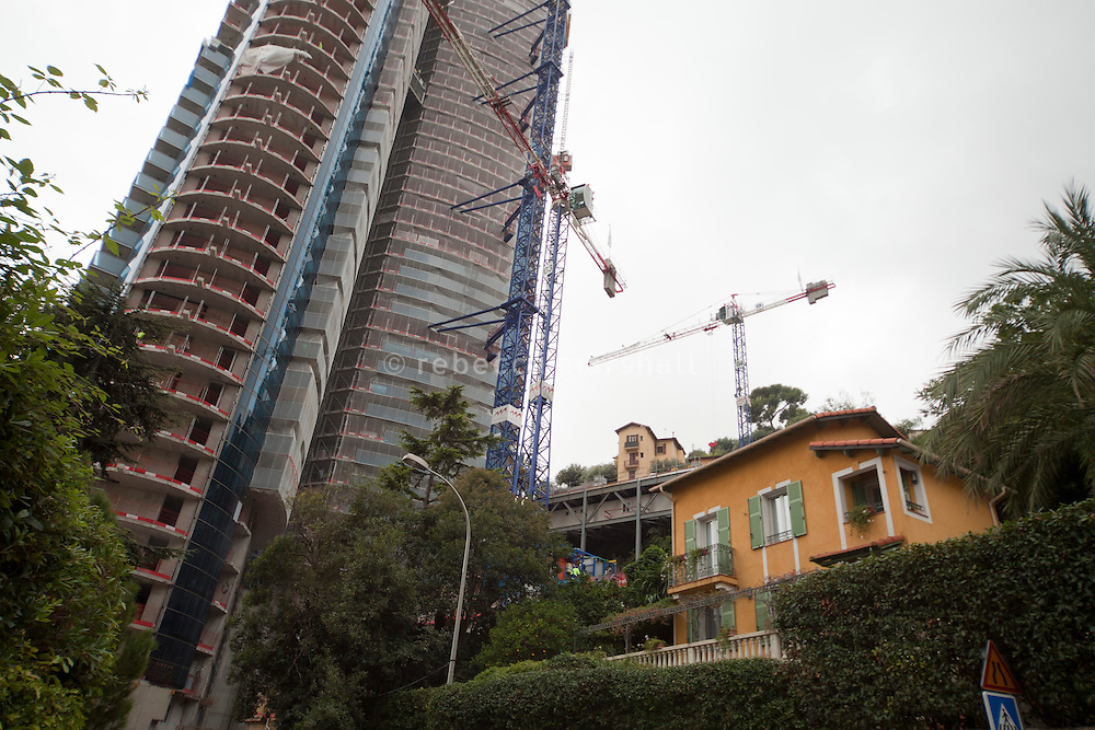 Neighbourhood houses are dwarfed next to the construction of the Tour Odéon, Monaco, 18 October 2013
