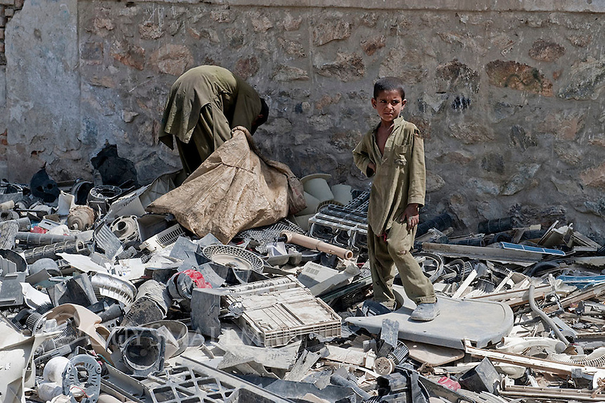 Impoverished Children collect plactic for recycling in Kabul. 18-9-10