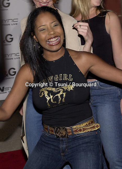 Shar Jackson (Moesha) and lead singer of MPLUZ arriving  at the world premiere of &quot;N'Sync&quot; Bigger than Live, The concert movie at the California Science Center IMAX Theatre in Los Angeles.  3/30/2001    &copy; Tsuni<br />                                                                                                              -            JacksonShar05.jpg