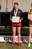 Jackson sophomore Kaylee Wilson poses with her All-State medal and certificate after a 17th-place finish at the 2016 State Cross Country Championships in Jefferson City, Saturday, November 5.