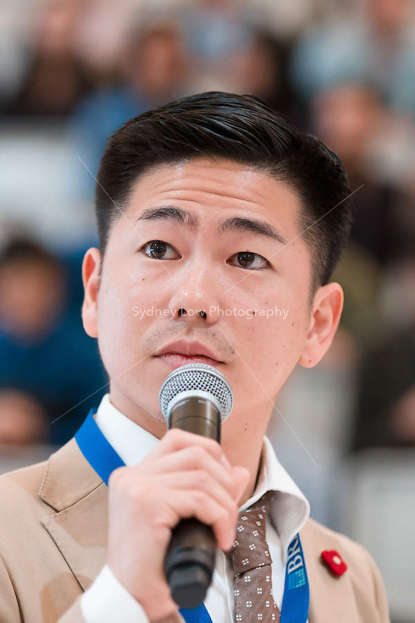 March 15, 2015: The 2014 World Barista Champion Hidenori Izaki of Japan talks to the audience during Matt Lewin's performance in the 2015 Australian Barista Championships at the Showgrounds, Melbourne, Australia. Photo Sydney Low.