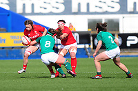 Alisha Butchers of Wales is tackled by Claire McLaughlin of Ireland during the Women's Six Nations match between Wales and Ireland at Cardiff Arms Park, Cardiff, Wales, UK. Sunday 17 March 2019