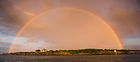 A full rainbow illuminates Castle Hill Inn and Lighthouse in Newport, ,Rhode Island.