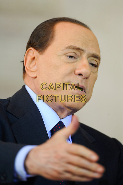 SILVIO BERLUSCONI .Italy-France summit between the President of the Italian Council of Ministers Silvio Berlusconi and French President Nicholas Sarkozy at Villa Madama, Rome, Italy April 26th 2011..portrait headshot political politics president prime minister navy blue suit tie hand .CAP/EPS/GG.©Giuseppe Giglia/EPS/Capital Pictures