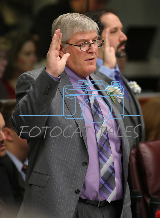 Nevada Assemblyman Skip Daly, D-Sparks, takes the oath of office during the opening day of the 77th Legislative Session in Carson City, Nev. on Monday, Feb. 4, 2013. <br /> Photo by Cathleen Allison