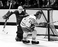 Seals #21 Stan Weir and Detroit goalie Terry Richardson, (1975 photo/Ron Riesterer)
