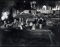 BNPS.co.uk (01202 558833)<br /> Pic:  Juliens/BNPS<br /> <br /> Filming the burning of Atlanta.<br /> <br /> Amazing behind the scenes photos of the classic film Gone With The Wind have come to light 80 years later.<br /> <br /> The comprehensive archive of over 800 images includes candid snaps of the leads Clark Gable and Vivien Leigh unwinding between takes.<br /> <br /> One extraordinary photo shows the pair still in costume playing a board game, with another capturing the burning of Atlanta in the film.<br /> <br /> There is also a picture of the director Victor Fleming holding the novel 'Gone With The Wind' while in discussion with Leigh.