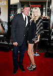 """HOLLYWOOD, CA. - June 02: Wayne Gretzky and guest arrive at the Los Angeles premiere of """"The Hangover"""" at Grauman's Chinese Theatre on June 2, 2009 in Hollywood, California."""