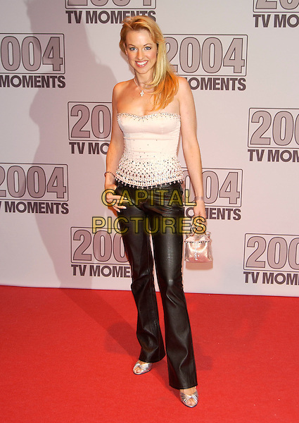"SARAH MANNERS.""2004 TV Moments Awards Ceremony"" .at BBC Television Centre.London 22 January 2005.full length black leather trousers white strapless top boob tube.www.capitalpictures.com.sales@capitalpictures.com.©Capital Pictures"