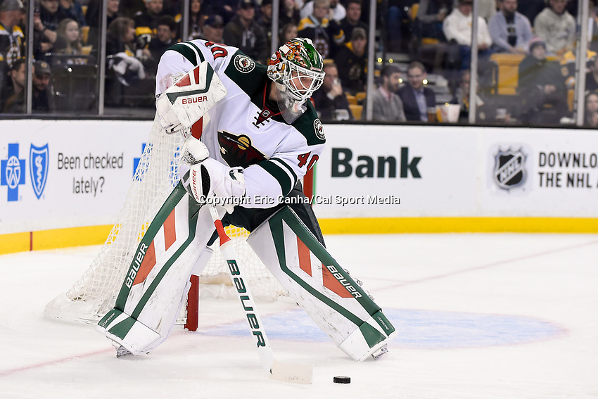 Thursday, November 19, 2015: Minnesota Wild goalie Devan Dubnyk (40) flicks the puck back during the National Hockey League game between the Minnesota Wild and the Boston Bruins held at TD Garden, in Boston, Massachusetts. The Bruins defeat the Wild 4-2. Eric Canha/CSM