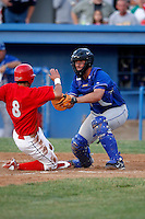 June 19, 2009:  Catcher Jack Murphy of the Auburn Doubledays blocks the plate as Niko Vasquez tries to score during a game at Dwyer Stadium in Batavia, NY.  The Doubledays are the NY-Penn League Short-Season A affiliate of the Toronto Blue Jays.  Photo by:  Mike Janes/Four Seam Images