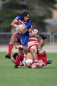 Latiume Fosita attempts to step free from the tangle of Karaka tacklers. Counties Manukau Premier Club Rugby Semi-final game between Ardmore Marist and Karaka, played at Bruce Pulman Park Papakura, on Saturday July 14th 2018.<br /> Ardmore Marist won the game 53 - 8 after leading 22 - 3 at halftime. <br /> Photo by Richard Spranger.