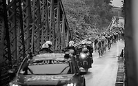 peloton on their way to Torino passing a bridge being proceeded by a bunch of photo-moto's<br /> <br /> stage 21: Cuneo - Torino 163km<br /> 99th Giro d'Italia 2016