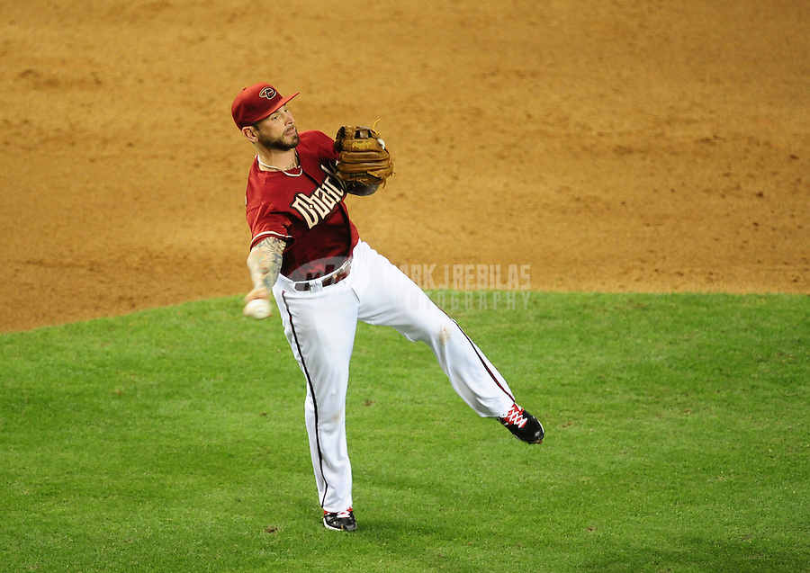 May 9, 2012; Phoenix, AZ, USA; Arizona Diamondbacks third baseman Ryan Roberts makes an off balance throw in the sixth inning against the St. Louis Cardinals at Chase Field. The Cardinals defeated the Diamondbacks 7-2. Mandatory Credit: Mark J. Rebilas-