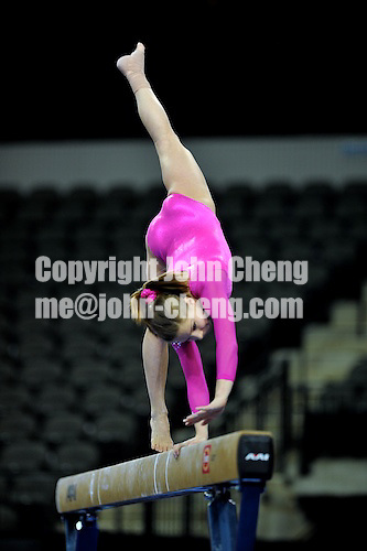 02/20/09 - Photo by John Cheng for USA Gymnastics.  US gymnast Mackenzie Caquatto performs on balance beam in a meet against Japan before the Tyson American Cup at Sears Centre Arena in Chicago.