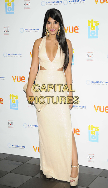 Jasmin Walia<br /> The &quot;It's A Lot&quot; UK film premiere, Vue West End cinema, Leicester Square, London, England.<br /> October 21st, 2013<br /> full length white dress slit split  cut out away cream cleavage low cut neckline clutch bag<br /> CAP/CAN<br /> &copy;Can Nguyen/Capital Pictures