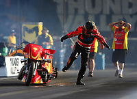 Jun 16, 2017; Bristol, TN, USA; NHRA top fuel nitro Harley Davidson rider Chris Smith jumps off his motorcycle after exploding an engine on fire during qualifying for the Thunder Valley Nationals at Bristol Dragway. Mandatory Credit: Mark J. Rebilas-USA TODAY Sports