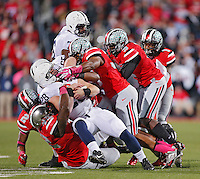 The Buckeyes gang tackle Penn State Nittany Lions running back Zach Zwinak (28) in second half action at Ohio Stadium on October 26, 2013.  (Chris Russell/Dispatch Photo)