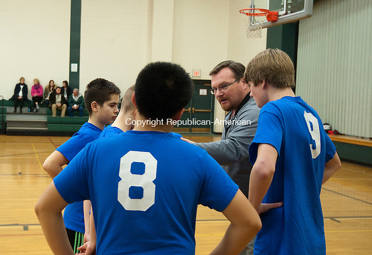 MIDDLEBURY, CT--- -012716JS03--Blue Demon coach Bob Twombly talks with his players during the Middlebury Parks and Recreation's recreational basketball league game Wednesday at Memorial Middle School in Middlebury.<br />   Jim Shannon Republican-American