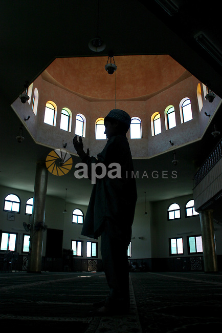 A Palestinian prays at a mosque on the first day  for the holy fasting month of Ramadan in the west bank city of Nablus on Aug 22, 2009. Photo by Nedal Shtieh