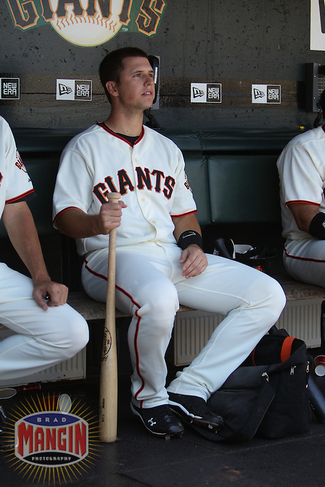 SAN FRANCISCO - JUNE 27:  Buster Posey of the San Francisco Giants sits in the dugout during the game against the Boston Red Sox at AT&T Park on June 27, 2010 in San Francisco, California. Photo by Brad Mangin