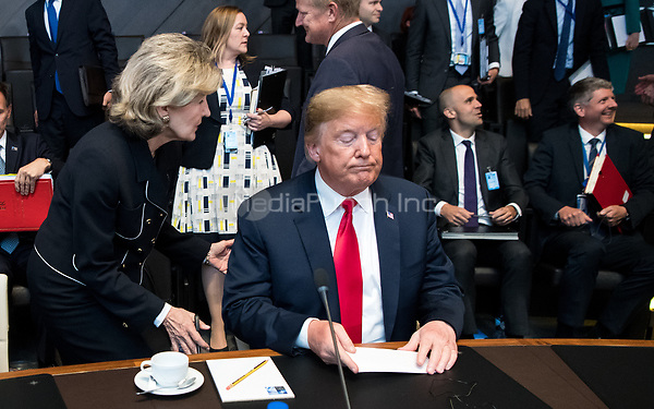 11 July 2018, Brussels, Belgium: Kay Bailey Hutchison, United States Permanent Representative to NATO, speaks with Donald Trump, President of the United States of America, at the first work session of the North Atlantic council at the NATO Summit. From 11 July 2018 until 12 July 2018 government heads of the 29 NATO member states and European Union representatives, will participate in the Summit of the North Atlantic Treaty Organization. Photo: Bernd von Jutrczenka/dpa /MediaPunch ***FOR USA ONLY***