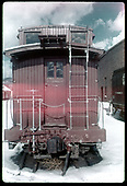 View of end platform of Caboose #0503 in snow in Chama yard.<br /> D&amp;RGW  Chama, NM
